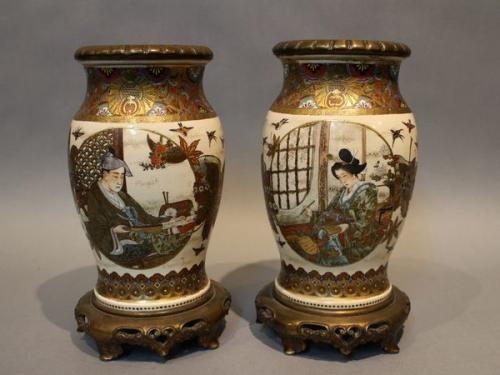 A pair of 19th century japanese satsuma vases on gilt bronze stands