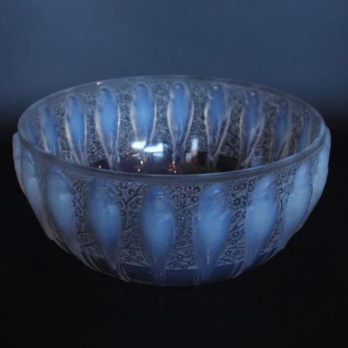 A frosted an opalescent glass bowl depicting parakeets in relief. Hand etched 'R Lalique France' to underside.  Marcilhac, R Lal