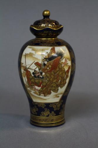 A small 19th century japanese satsuma vase and cover