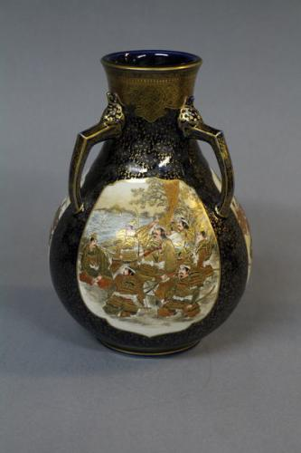 A 19th century japanese satsuma vase with three decorative handles