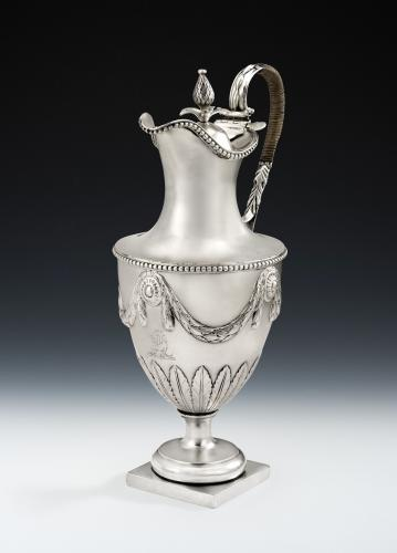 An exceptional & very rare George III Neo Classical Water/Wine Ewer made in London in 1768 by John Carter II. The decorative des