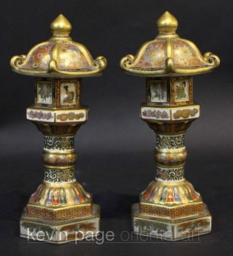 A pair of Japanese satsuma pagodas intricately painted with a gold and floral design, with panels of ladies.