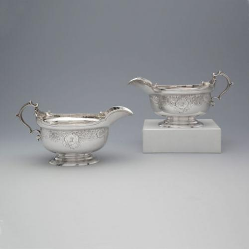A Pair of George II Antique English Silver Sauce Boats