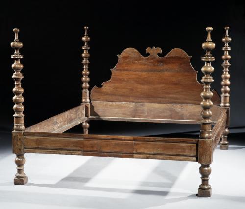 A massive 17th century Italian walnut tester bed