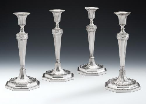 A very fine & unusual set of four George III Octagonal Candlesticks made by Daniel Smith & Robert Sharp and assayed in Sheffield