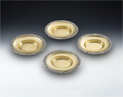 A very fine and rare set of four George III Silver Gilt Dishes made in London in 1817 by Solomon Royes and John East Dix.