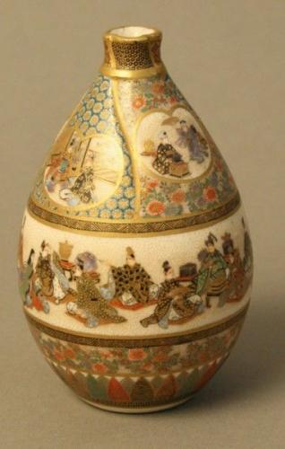 a miniature intricately painted oval satsuma vase