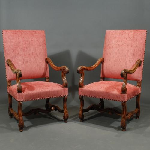 A Pair of Louis XIV Style Walnut Jambes de Mouton Arm Chairs