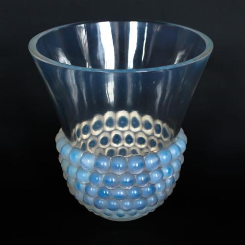 Graines, an Art Deco opalescent glass vase with a raised motif of blossoms.  Literature: Marcilhac, R Lalique Catalogue Raisonné