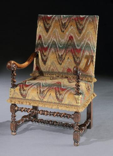 A Flemish, mid-17th century, walnut, open armchair upholstered in a re-created bargello with custom-made passmenterie