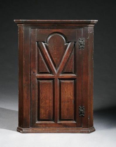 A late-17th centuy oak hanging corner cupboard