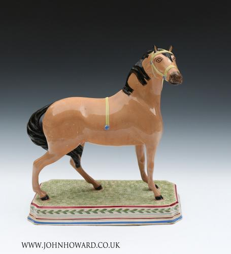 Antique pearlware pottery figure of a horse attributed to the Leeds Pottery early 19th century