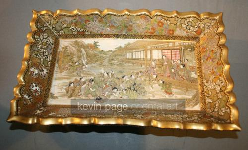 A satsuma tray depicting a sporting event