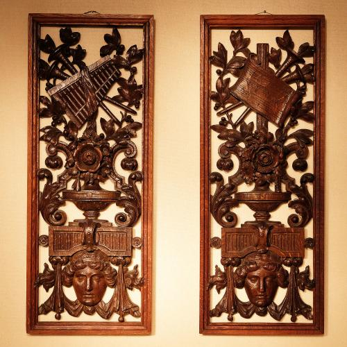 A Pair of Late 19th Century Carved and Pierced Musical Panels