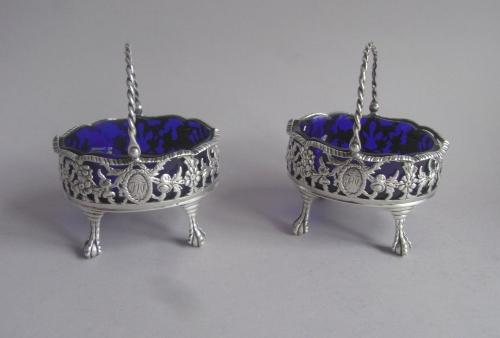"An extremely rare pair of early George III Cast ""Basket"" Salt Cellars made in London in 1770 by Robert & David Hennell."