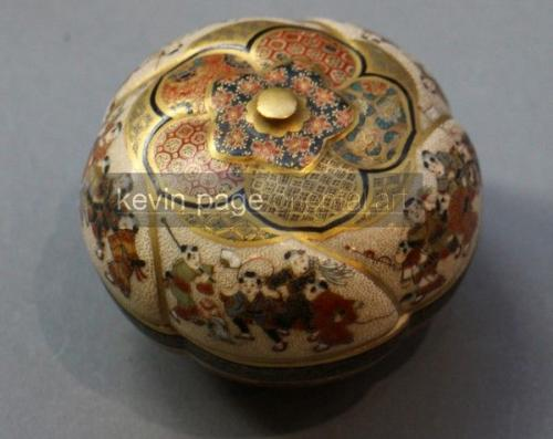 a japanese satsuma pot with a risque shunga image to the underside of the lid