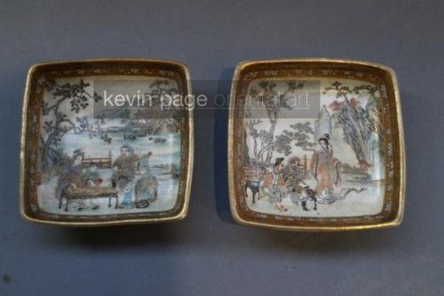 a pair of small japanese satsuma dishes decorated with scenes of people at leisure