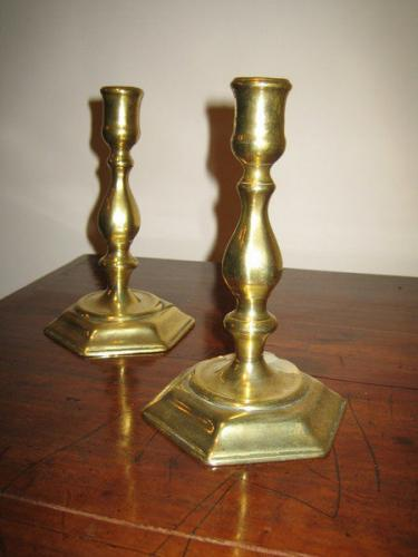 A good pair of early-18th century brass candlesticks with hexagonal bases