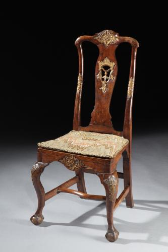 A rare, set of four, mid-18th century, Portuguese, parcel-gilt & walnut side chairs