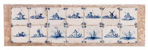 A stone plaque containing fourteen 18th century blue and white delft tiles