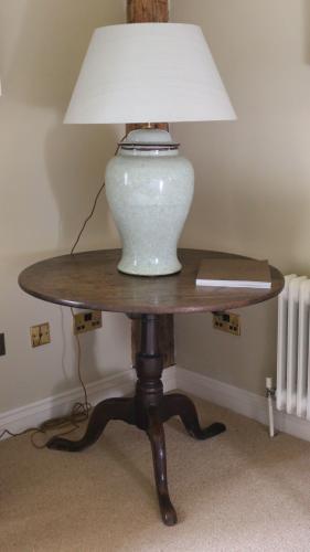 A mid-18th century mahogany tripod table