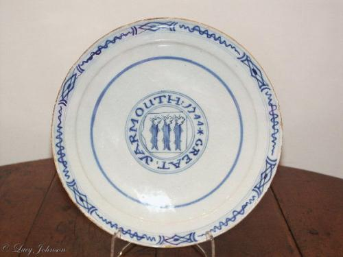 A rare, Dutch, delftware plate inscribed 'Great Yarmouth' & dated '1744'