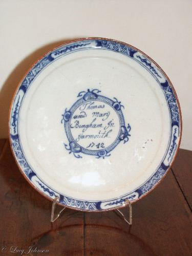 A rare, Dutch, delftware plate inscribed 'Thomas and Mary Bingham In Yarmouth' & dated '1742'