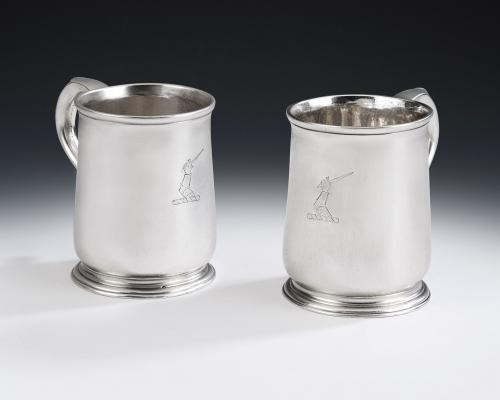 A very rare pair of early George II Mugs made in London in 1729 by Thomas Mason.