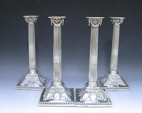 FOUR ANTIQUE GEORGE III SILVER CANDLESTICKS