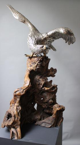 Three powerful sculptures of Eagles in different stages of taking off