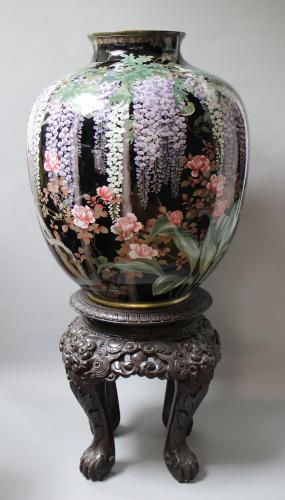 A suberb Japanese cloisonné vase with original carved wood base