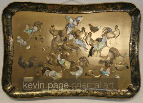 a gold lacquer tray with applied mother of pearl