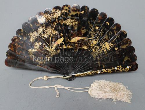 a fine elegant antique japanese tortoiseshell fan decorated with golden lacquer peacocks