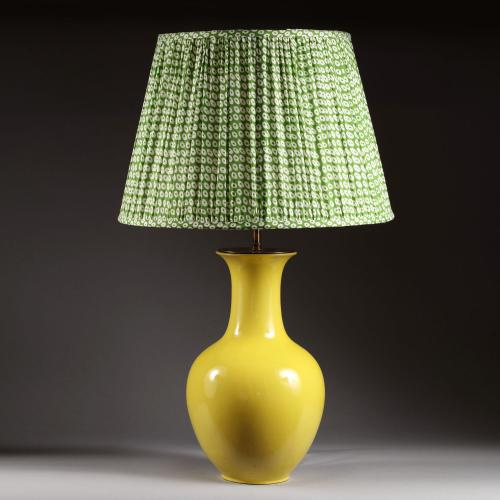 A single yellow vase as a lamp