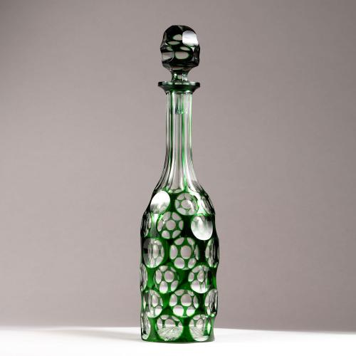 A cut glass bottle
