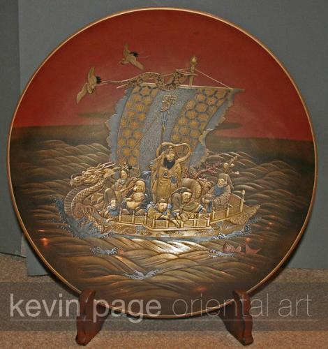 a lacquer dish depicting the 7 lucky gods in their boat