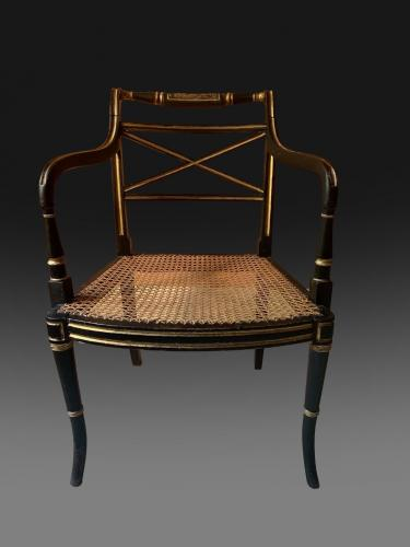 George III Armchair in ebonised beech with a caned seat and gilt decoration