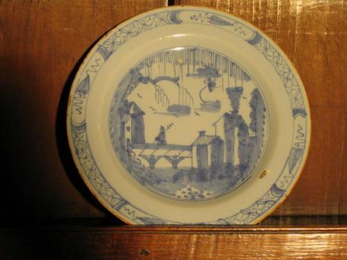 A small, late-18th century delftware plate