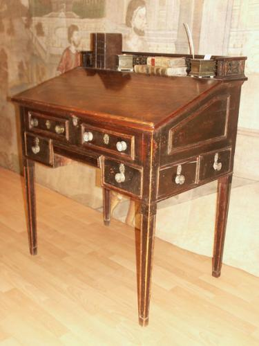 An unusual, late-18th century, mahogany estate bureau fitted with numerous secret drawers