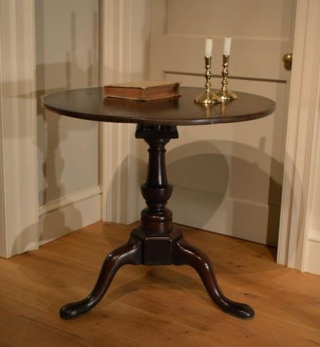 A George II oak tripod table. Circa 1730