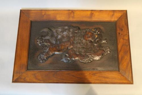 four japanese 19th century wood panels depicting shishi dogs