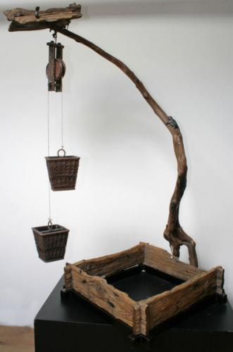 An unusual japanese aesthetic movement wooden well sculpture