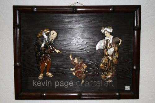 a wood ivory and lacquer wall panel depicting a dragon dancer, child and lady