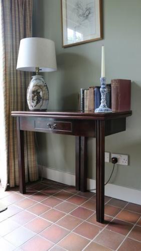 A late-18th/early-19th century mahogany card table