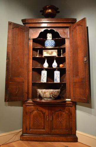 A George II oak standing corner cupboard