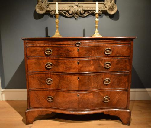 A George III Serpentine Chest attributed to Gillows. Circa 1790