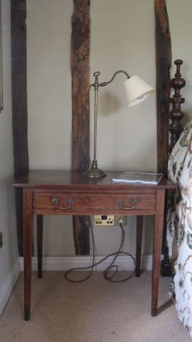 A 19th century mahogany sidetable with crossbanded top and boxwood stringing