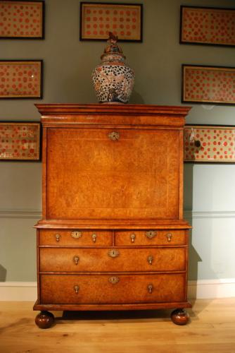 An early 18th Century walnut fall front writing cabinet Circa 1710