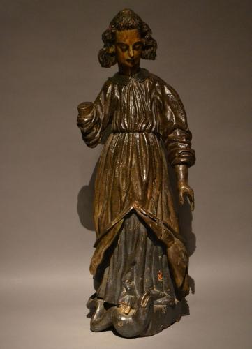 An early 16th century carved figure of the archangel St. Michael.