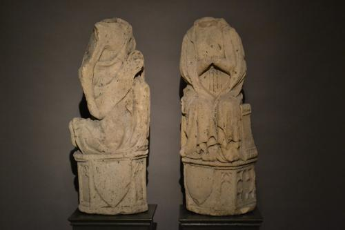 A pair of 14th/15th century limestone figures depicting The Annunciation.